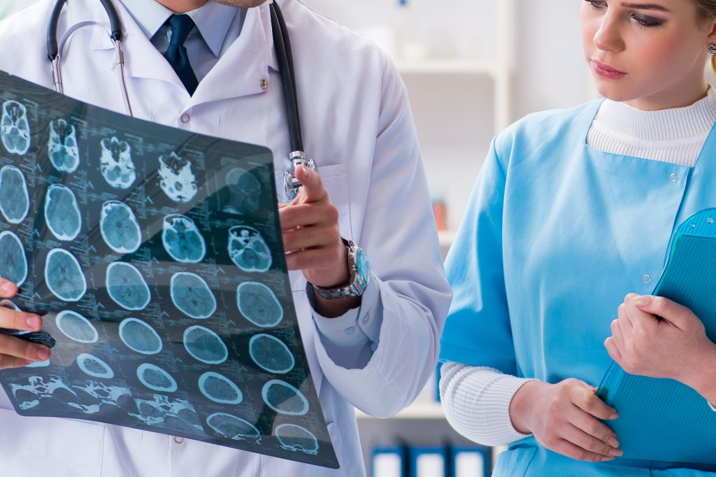 MRI technicians looking at X-Ray